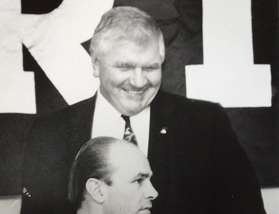 MSU head football coach George Perles speaks with ex-Spartan Kirk Gibson at the Spartan Football Bust at the Holiday Inn South, December 1993.