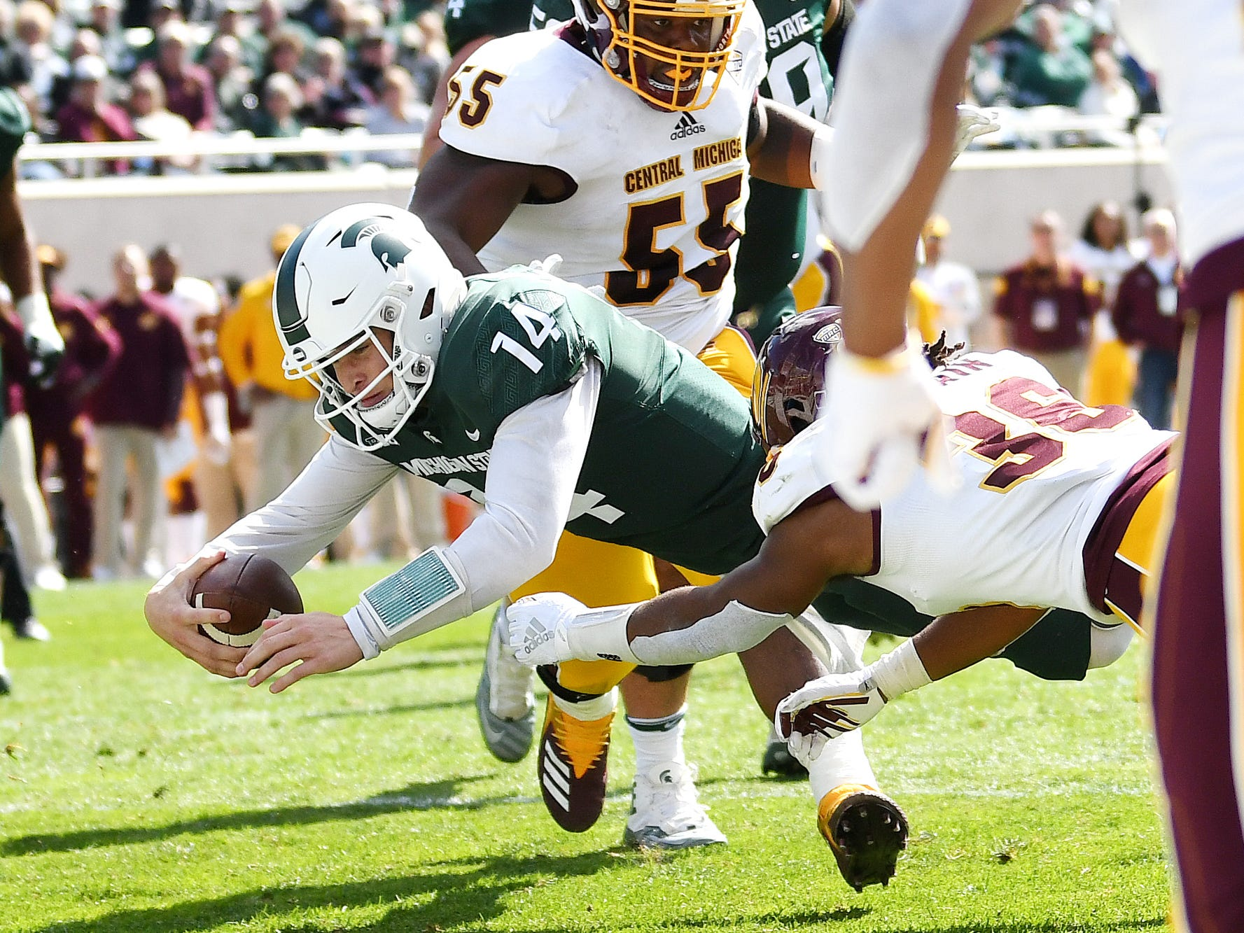 Michigan State's Brian Lewerke dives for a touchdown during the second quarter on Saturday, Sept. 29, 2018, at Spartan Stadium in East Lansing.