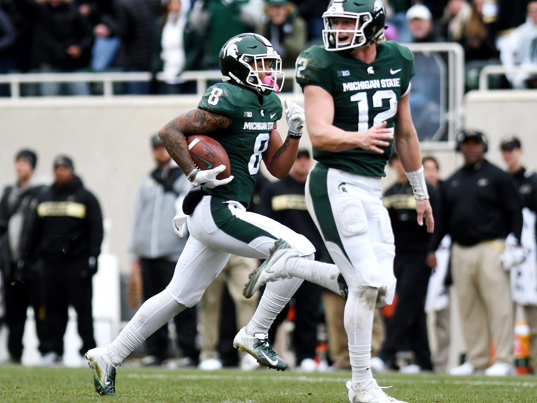 Michigan State's Jalen Nailor, left, runs for a touchdown as Rocky Lombardi, right, positions himself to help block during the fourth quarter on Saturday, Oct. 27, 2018, at Spartan Stadium in East Lansing.