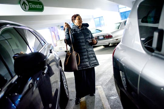 Lansing resident Qunita Williamson gets into her car in a parking garage after work on Thursday, Nov. 29, 2018, in downtown Lansing.