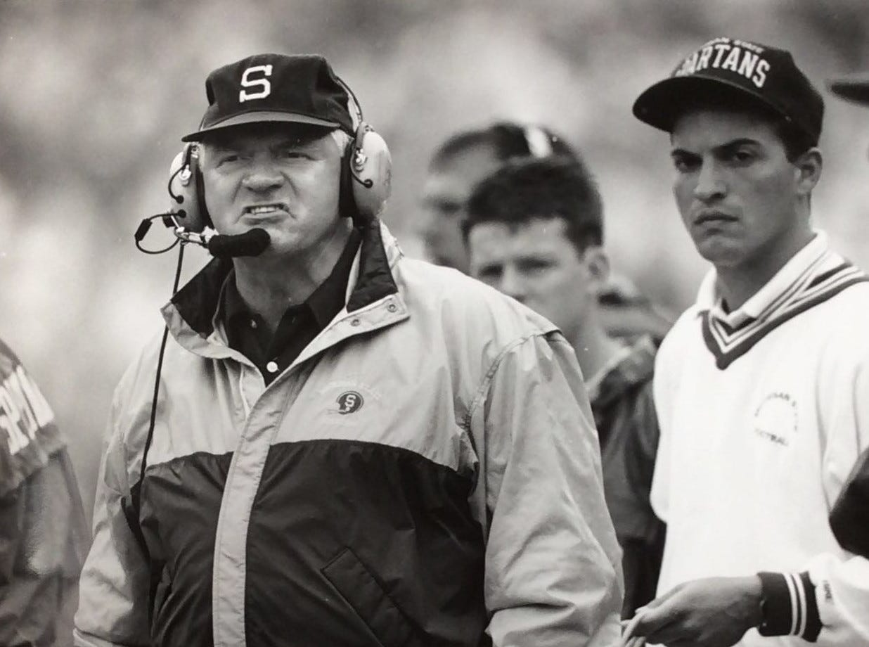 MSU head coach George Perles argues a call with referees in the fourth quarter. The play was ruled that an MSU receiver dropped the ball for a fumble recovery by CMU. MSU said that the catch was incomplete, September 1991.