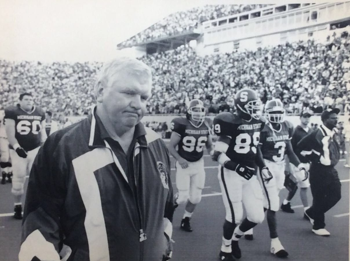 MSU head football coach George Perles walks off the field after the Spartans lost to Notre Dame, 21-20, Sept. 17, 1994, in East Lansing.