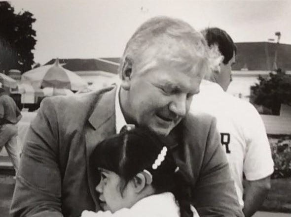 "MSU coach and AD George Perles hugs Bonnie Jo May at the ""hug zone"" during the third annual George Perles charity golf classic at the Country Club of Lansing, Aug. 13, 1990."