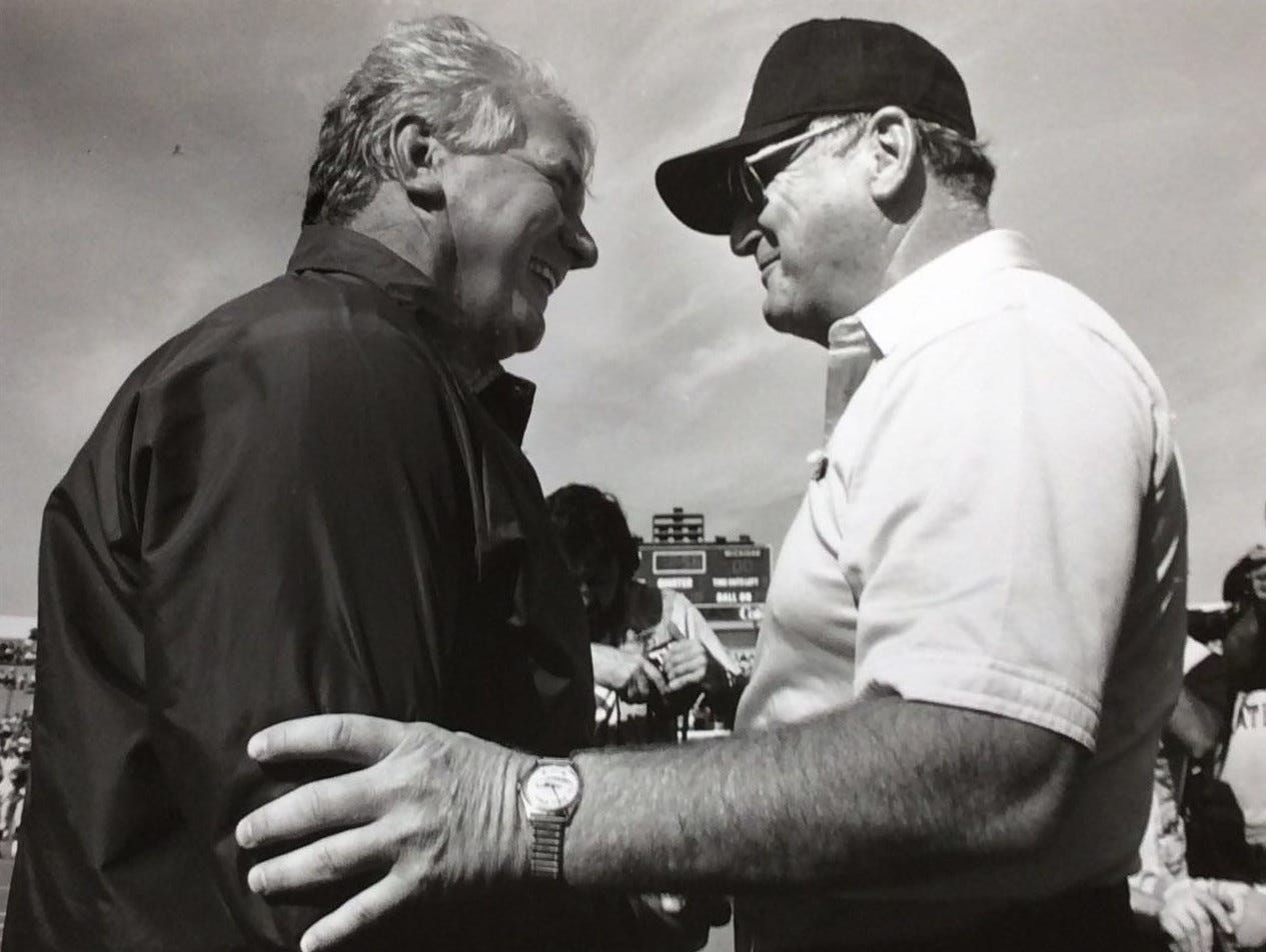 George Perles and Bo Schembechler meet at the 50-yard line before the game in East Lansing , Oct. 14, 1989.