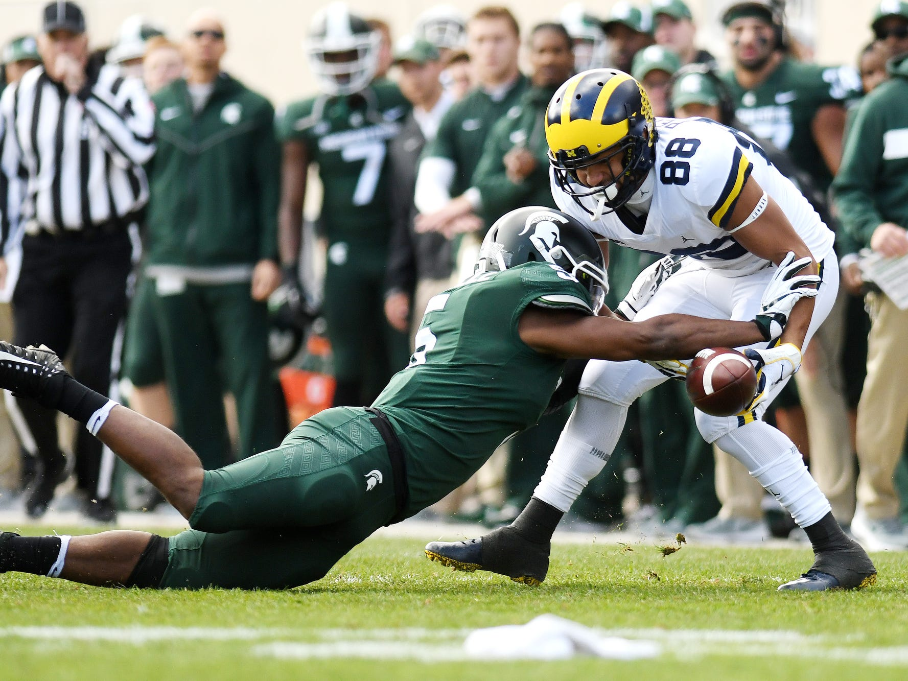 Michigan State's Andrew Dowell, left, breaks up a pass intended for Michigan's Grant Perry during the first quarter on Saturday, Oct. 20, 2018, in East Lansing.