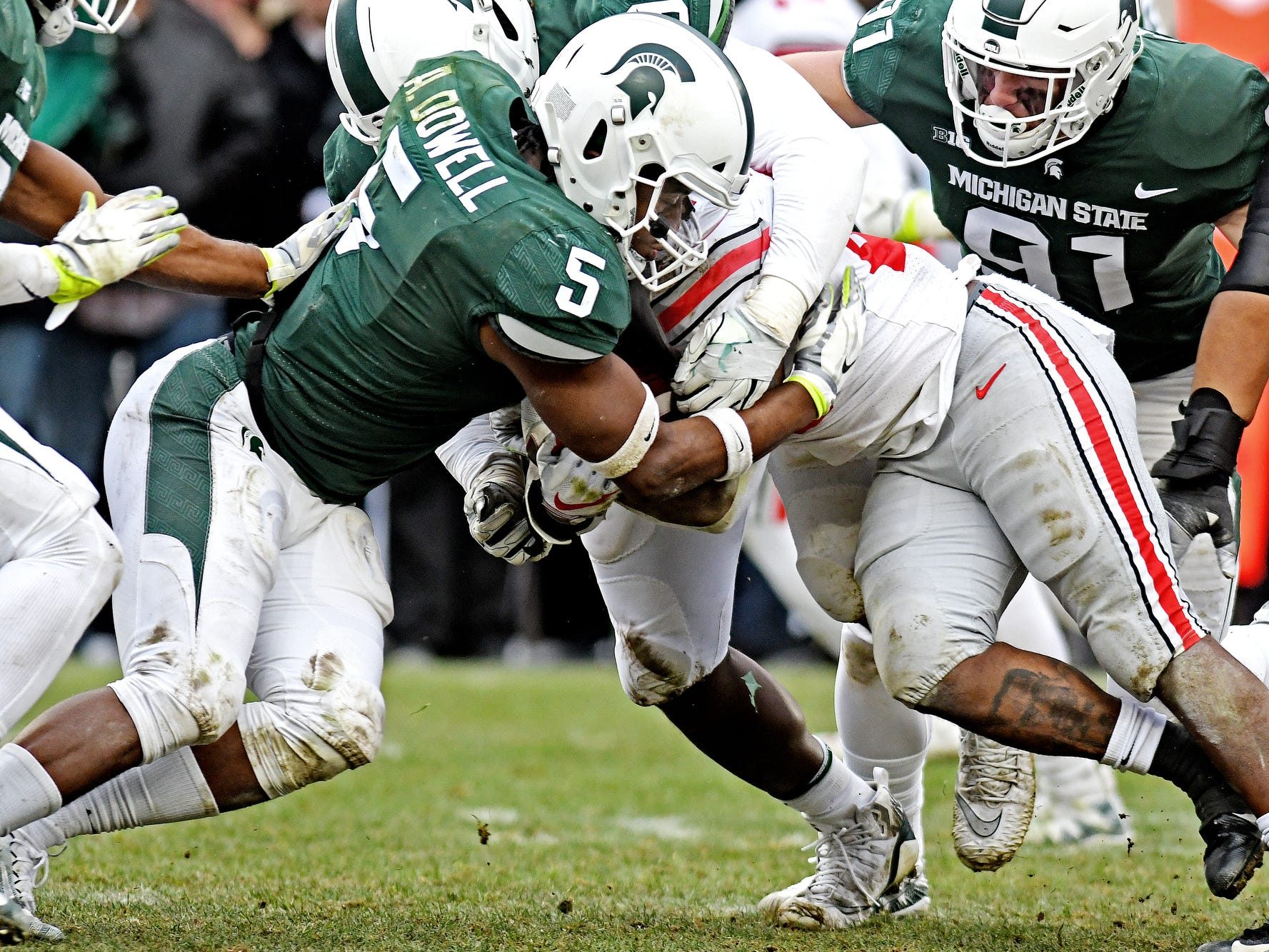 Michigan State's Andrew Dowell, left, tackles Ohio State's Mike Weber Jr. during the fourth quarter on Saturday, Nov. 10, 2018, in East Lansing.