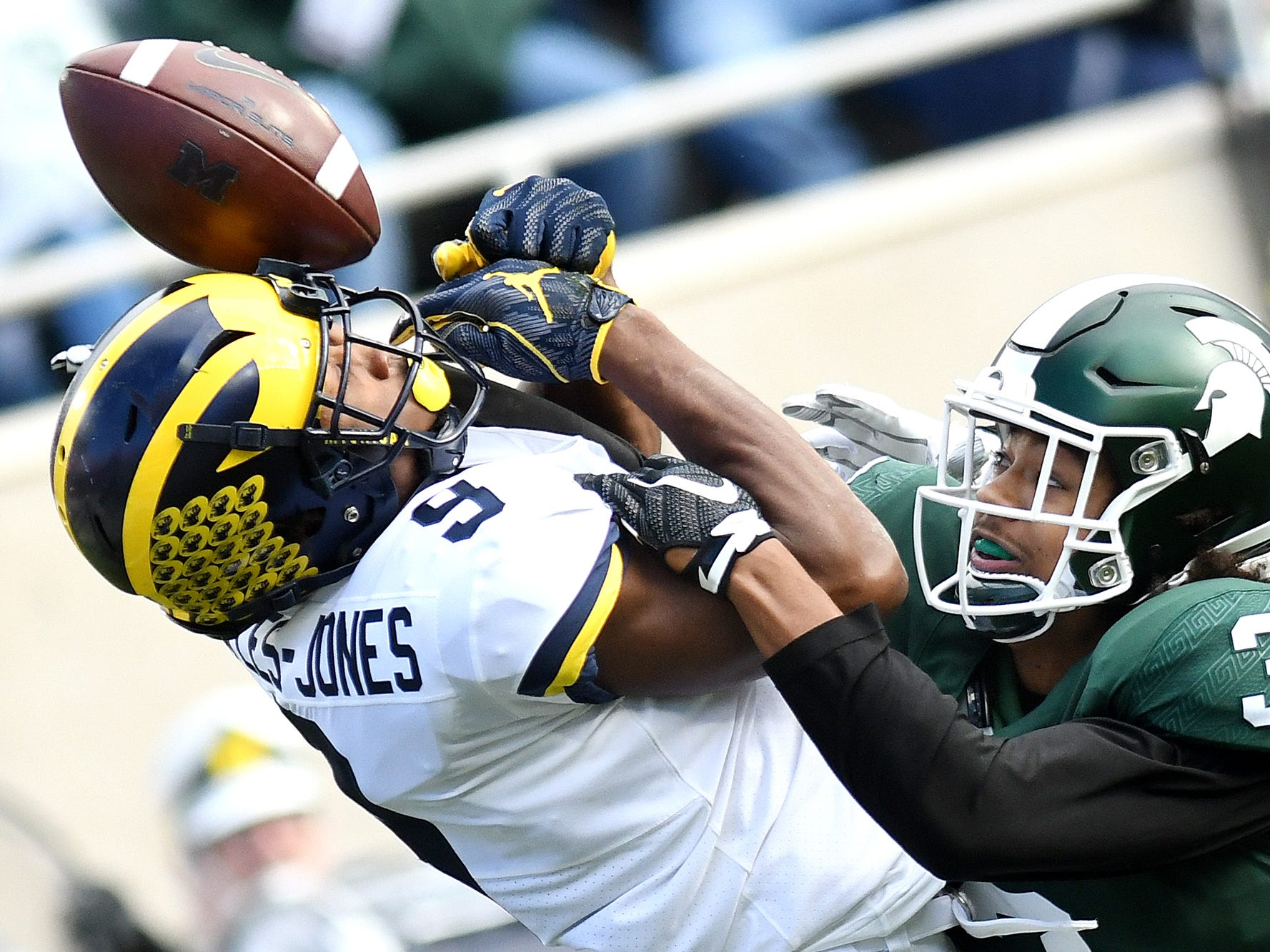 Michigan State's Xavier Henderson, right, breaks up a pass intended for Michigan's Donovan Peoples-Jones during the second quarter on Saturday, Oct. 20, 2018, in East Lansing.
