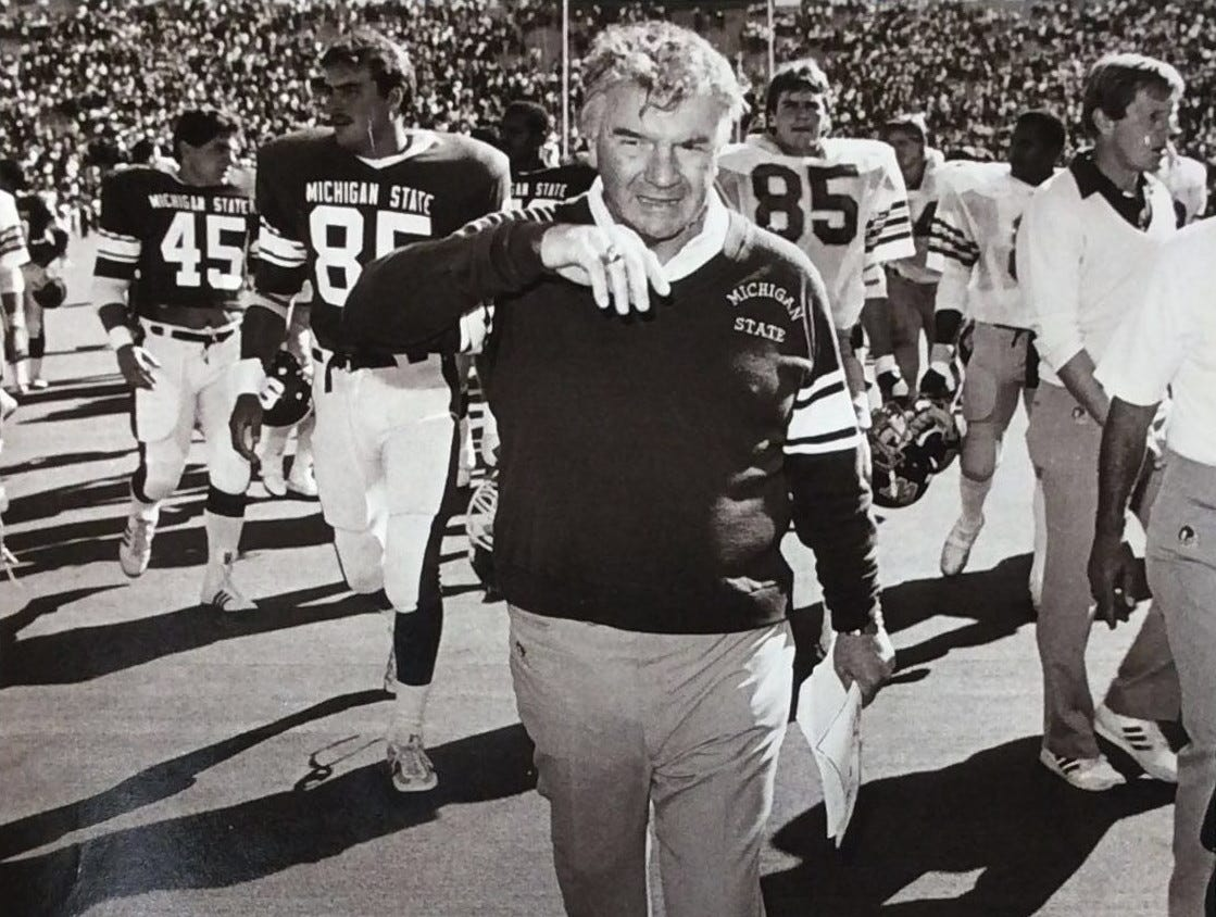 A relieved Coach George Perles walks off the field at the end of the game after wiping his brow, September 1985.