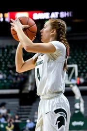 Michigan State's Taryn McCutcheon makes a 3-pointer against Virginia during the first quarter on Wednesday, Nov. 28, 2018, at the Breslin Center in East Lansing.