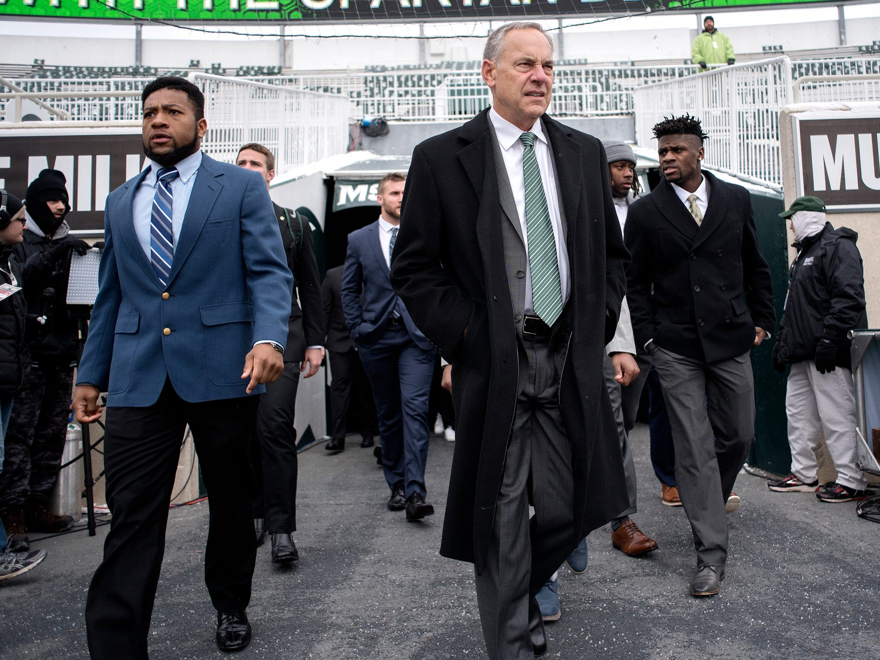 Michigan State head coach Mark Dantonio, center, enters Spartan Stadium with the team before the football game against Ohio State on Saturday, Nov. 10, 2018, in East Lansing.