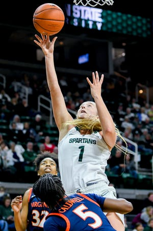 Michigan State's Tory Ozment shoots a basket against Virginia during the fourth quarter on Wednesday, Nov. 28, 2018, at the Breslin Center in East Lansing. The Spartans won 91-66.