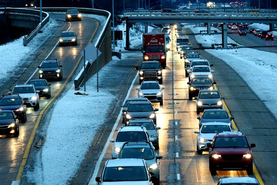 Traffic moves westbound on Interstate-496 near the on ramp on St. Joseph and Pine streets during the evening rush hour on Wednesday, Nov. 28, 2018, in downtown Lansing.