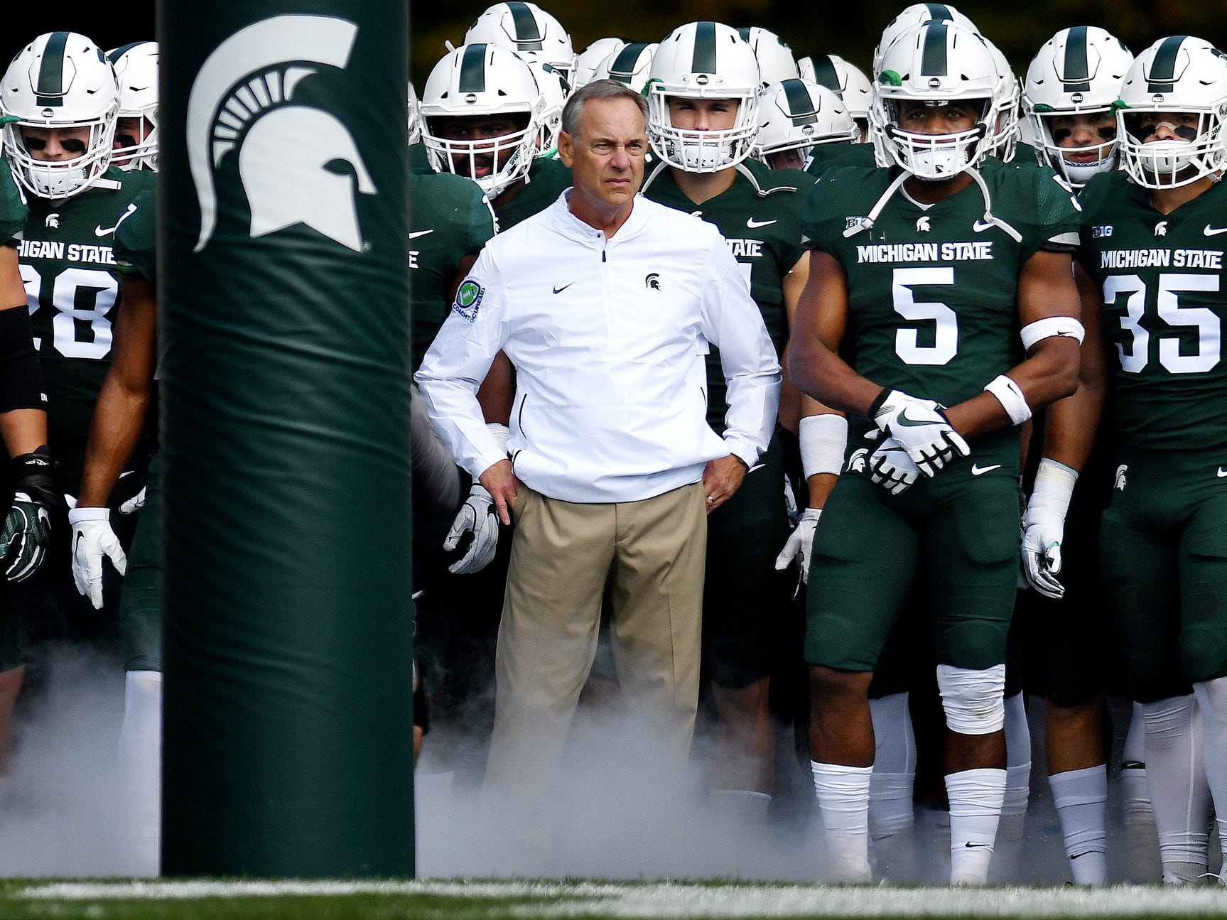 Head coach Mark Dantonio and the Michigan State Spartans prepare to take the field before their game against Central Michigan on Saturday, Sept. 29, 2018, at Spartan Stadium in East Lansing.