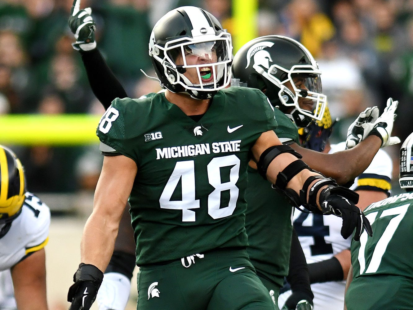 Michigan State's Kenny Willekes celebrates after the Spartans stop Michigan's offense on third down during the first quarter on Saturday, Oct. 20, 2018, in East Lansing.