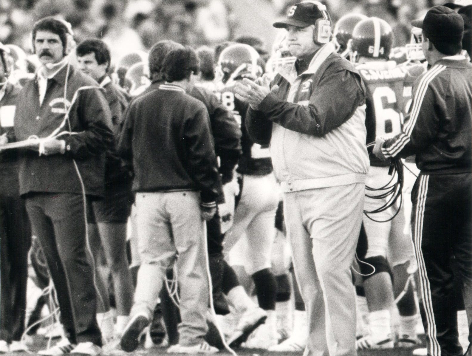Michigan State head coach George Perles applaudes his team during the third quarter at the Rose Bowl game against USC in Pasadena. The Spartans won the 1988 Rose Bowl, Jan. 1, 1988.