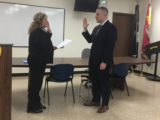 New Mansfield police officer Eric Schaaf  is sworn in by Safety-Service Director Lori Cope on Thursday.