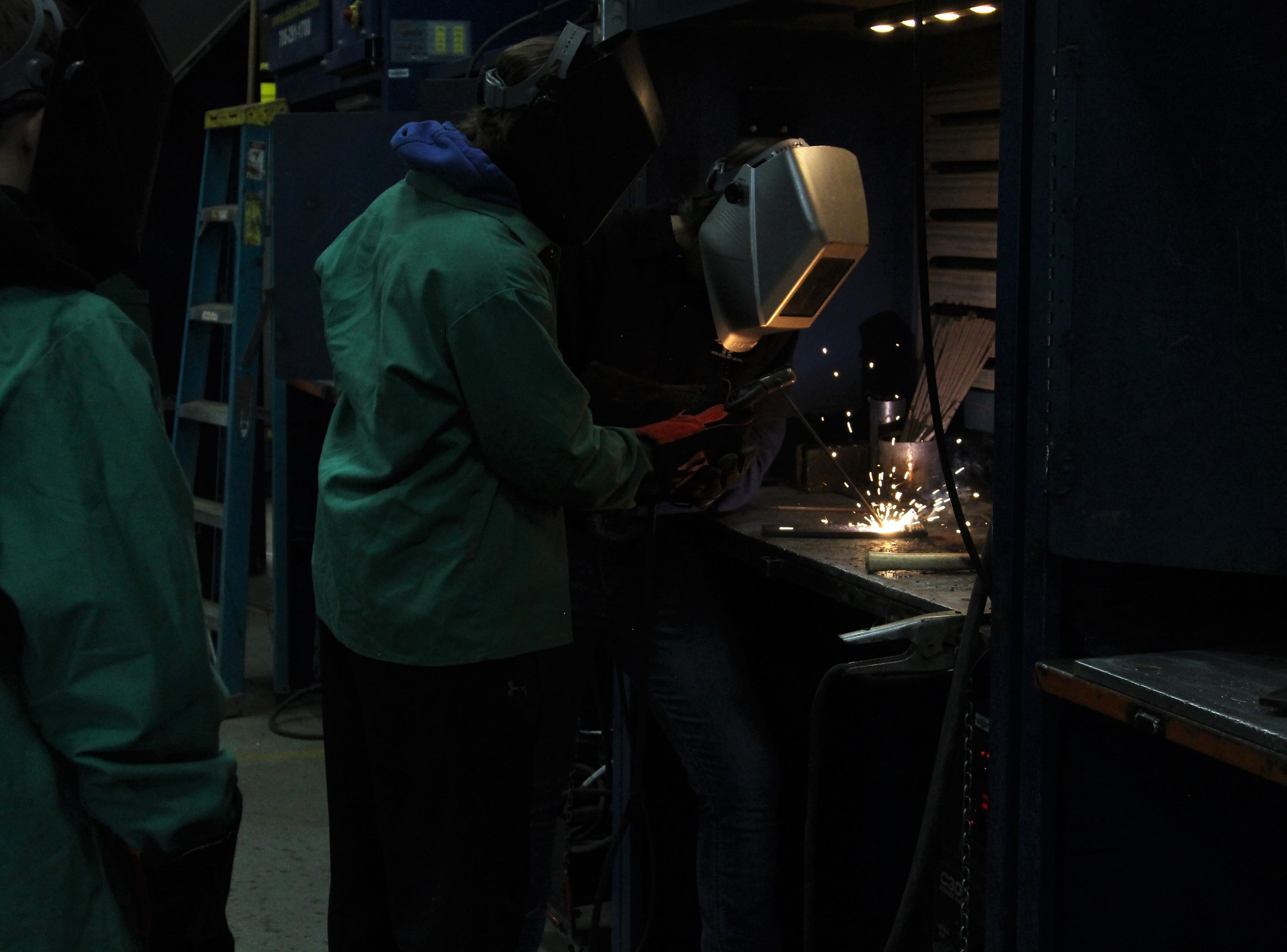 Tri-Rivers senior Brittany Fitch donned a welding helmet on Thursday as sophomores from Highland High School watched her work. They were part of 800 students who visited the career center that day and on Wednesday, as they bounced around several learning stations.