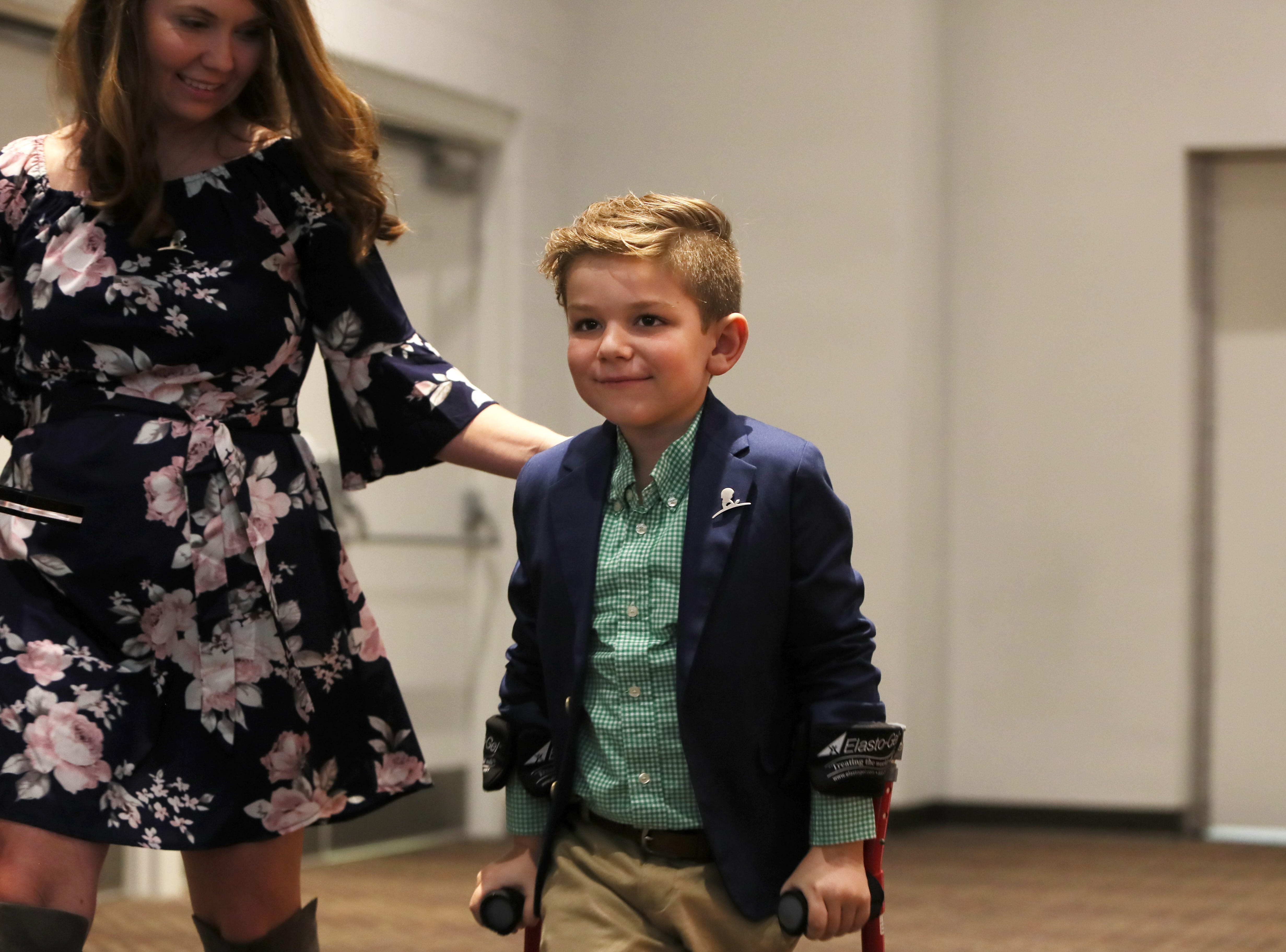 Kael Hill, 6, with his mom Ashley greet St. Jude Hero Among Us award recipient Kent Stoneking at the Cook Convention Center on Thursday, Nov. 29, 2018.