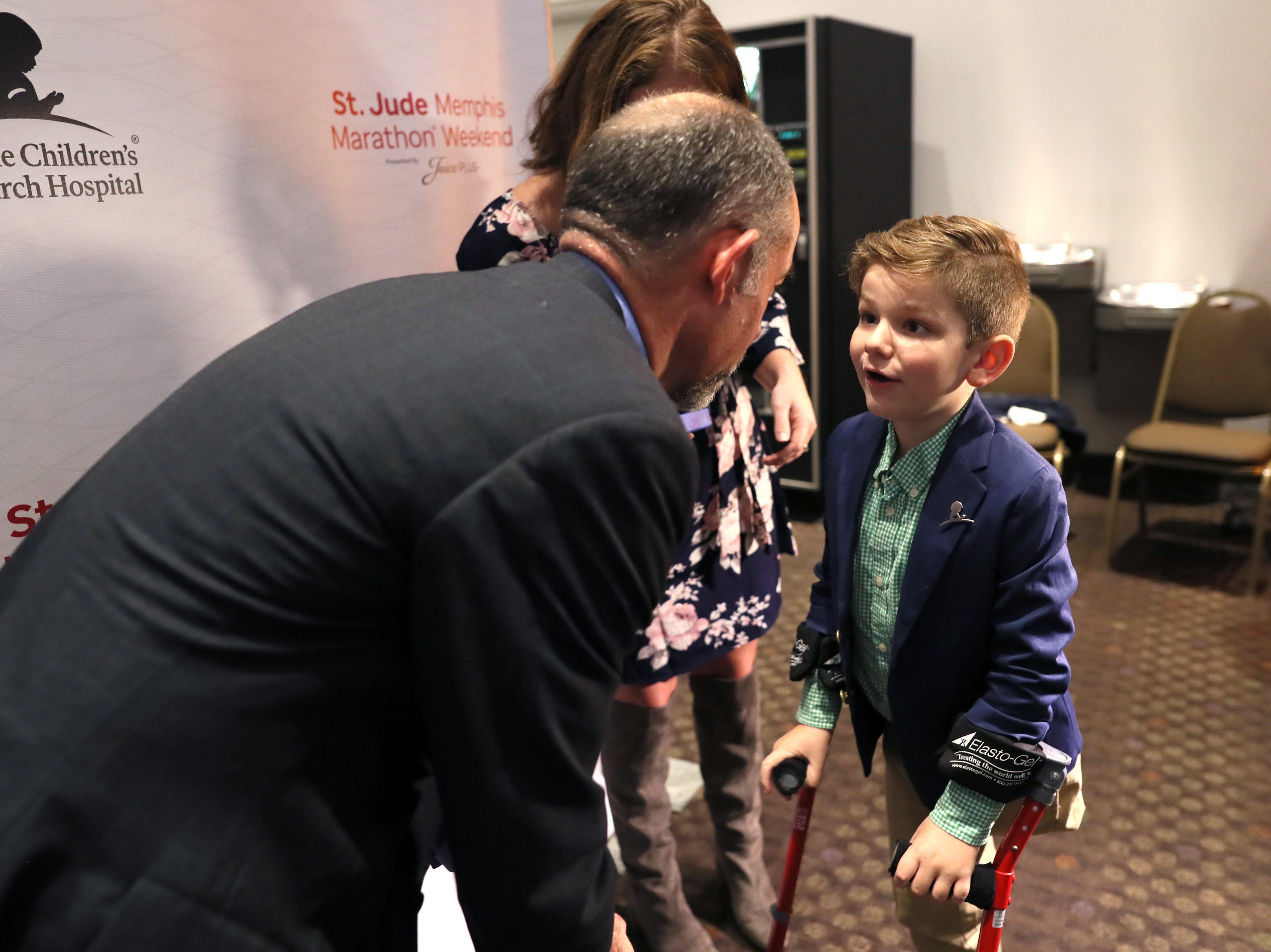 St. Jude Hero Among Us award recipient Kent Stoneking chats with Kael Hill, 6, during a press conference at the Cook Convention Center Thursday, Nov. 29, 2018.