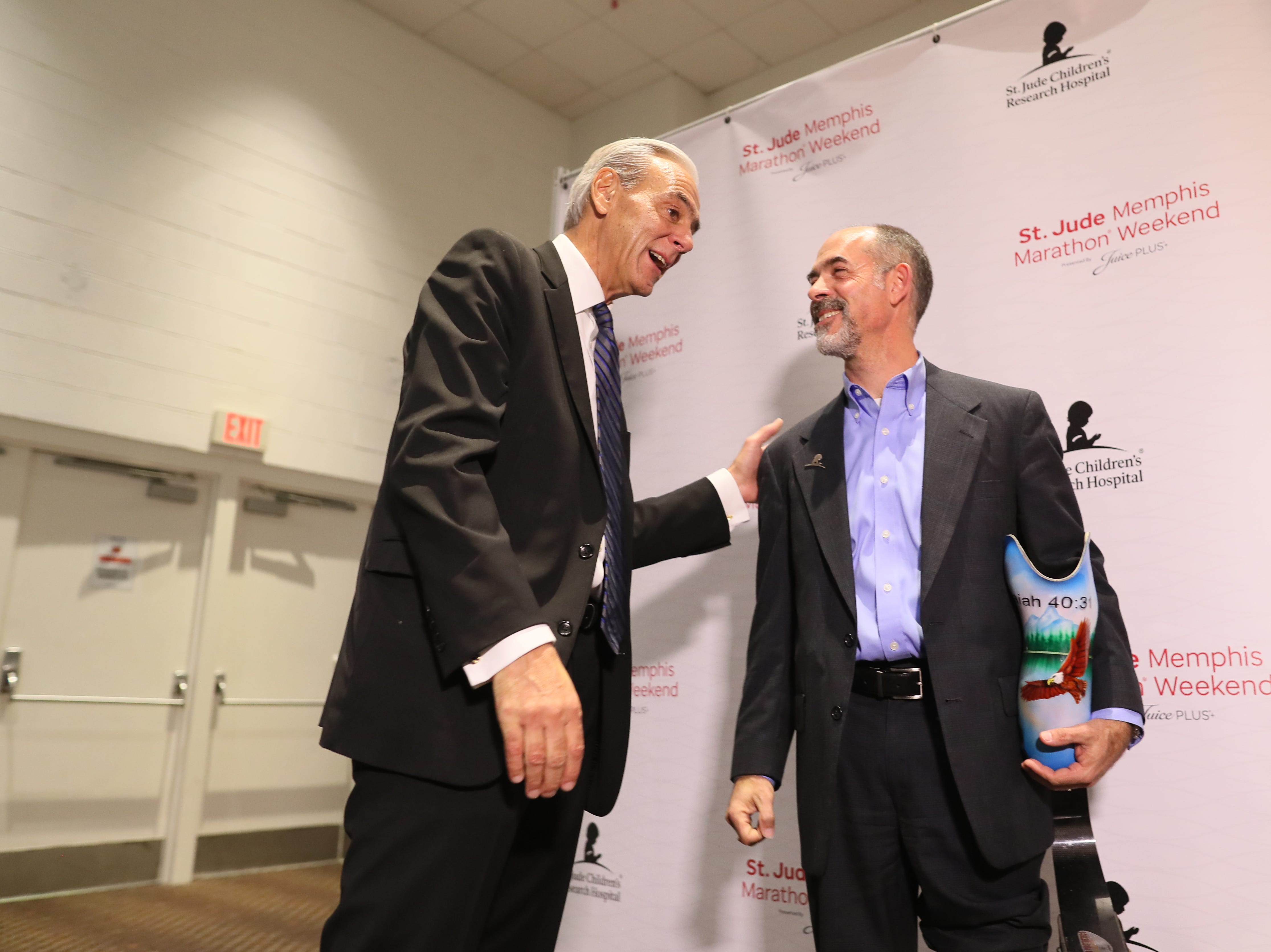 St. Jude Hero Among Us award recipient Kent Stoneking chats with ALSAC President and CEO Rick Shadyac during a press conference at the Cook Convention Center Thursday, Nov. 29, 2018.