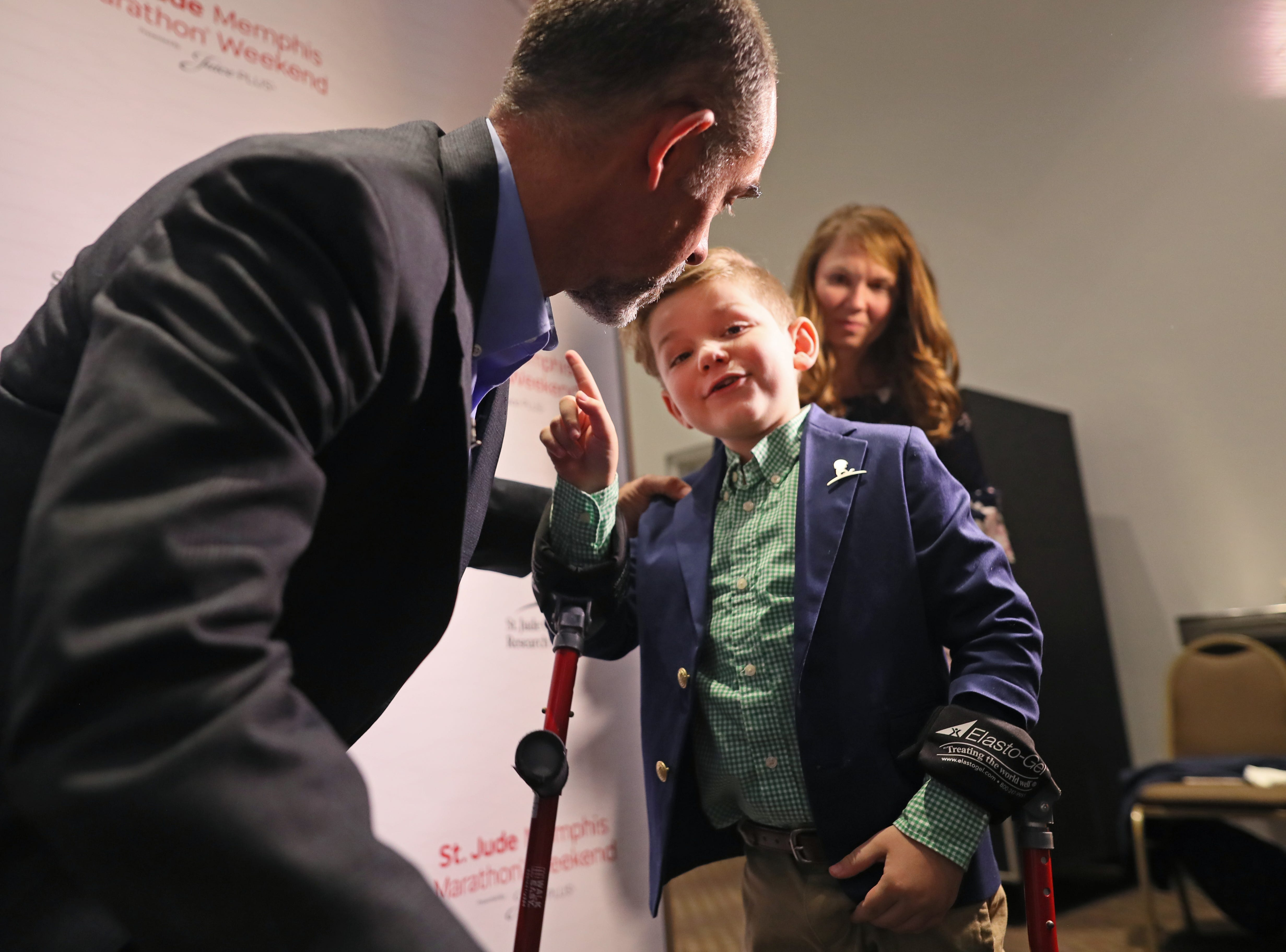 "Kael Hill, 6, tells Kent Stoneking ""You're my hero,"" as the two share the sentiment with each other during a press conference at the Cook Convention Center on Thursday, Nov. 29, 2018. Stoneking, who lost his leg in a motorcycle accident, has been an ambassador for St. Jude, running in their annual marathon to help children like Kael, who was a patient at the children's hospital."