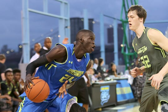 Thon Maker (left) drives to the basket during the Under Armour Elite 24 game for top high school players on Aug. 23, 2014 in Brooklyn, New York.