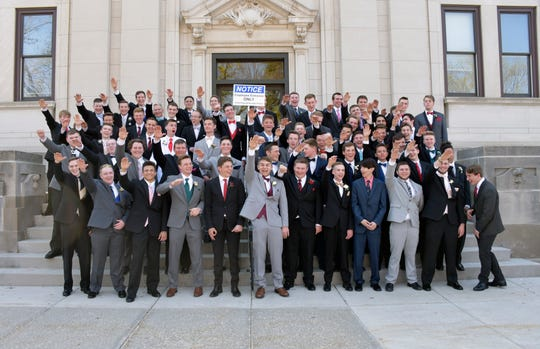 In this May 2018 photo provided by Peter Gust, a group of Wisconsin high school boys stand on the steps outside the Sauk County Courthouse in Baraboo. The image has drawn widespread condemnation because of the appearance that some of the students are giving a Nazi salute.