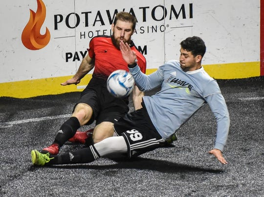 Milwaukee Wave defender Andre Hayne and Chicago Mustangs defender DJ Albert in a MASL exhibition game at the Arena.