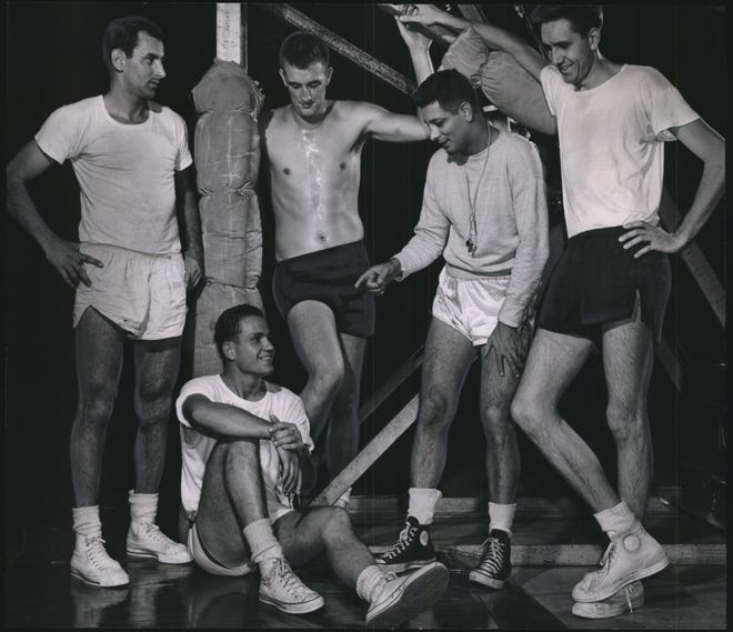 Grant Wittberger (right) joined other Milwaukee Hawks newcomers in camp in 1953. Although he signed with the team, he did not play in a game in the NBA.