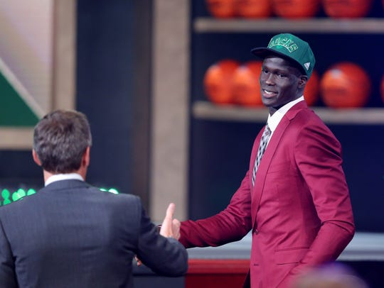 Thon Maker makes his way to the stage as the 10th overall pick in the 2016 NBA Draft at the Barclays Center in Brooklyn, New York.