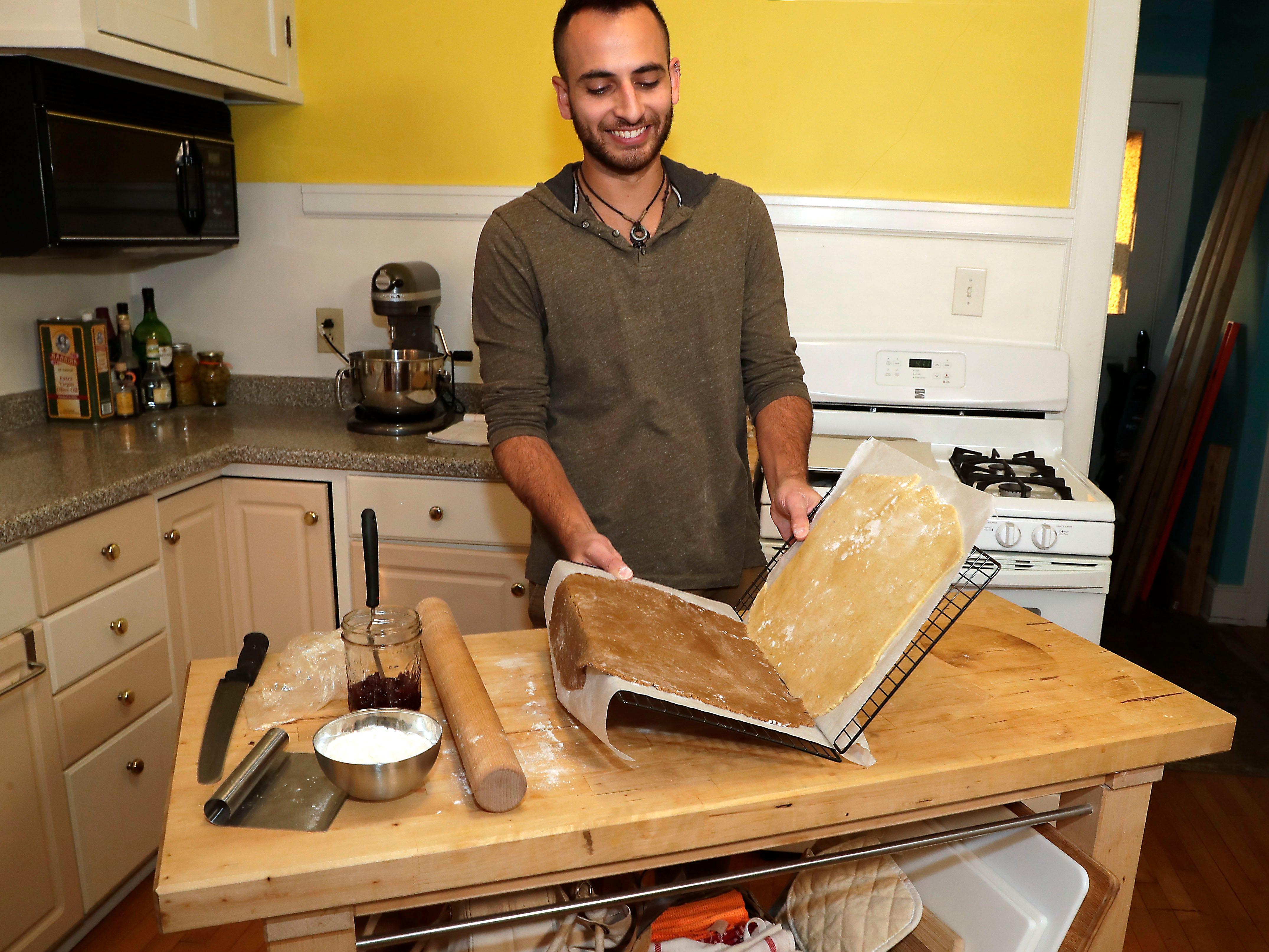 He makes use of cooling racks to stack the two doughs by folding them together like a book.