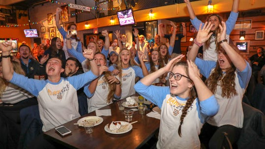 The Marquette volleyball team celebrates its seeding while watching the NCAA tournament selection show.