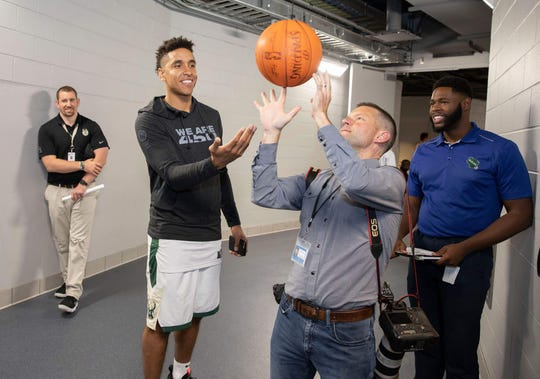 Mike De Sisti and Milwaukee Bucks point guard Malcolm Brogdon trade spins at the Bucks media day.