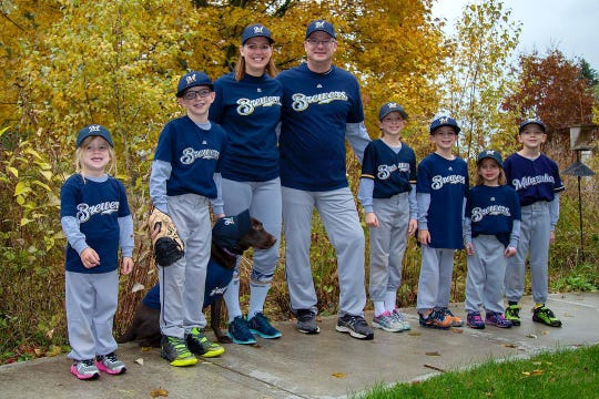 The Tomczuk family, avid Milwaukee Brewers fans, dressed up in Brewers uniforms for Halloween in 2018.