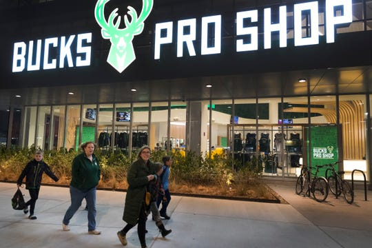 Fans walk past the Milwaukee Bucks Pro Shop at Fiserv Forum that is accessible without a ticket into the arena.