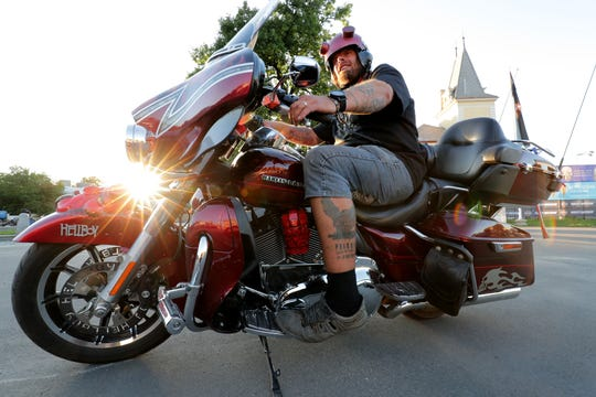 Jiri Rredrag Schon, from Prague, sports his Harley-Davidson 115th anniversary Prague tattoo while on his Harley Davidson motorcycle near the Holešovice Exhibition Grounds where the anniversary celebration took place in Prague.