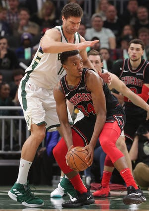 Bucks center Brook Lopez forces Bulls forward Wendell Carter Jr. to scramble to find a teammate.