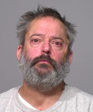 Douglas Slock II, after his arrest Thursday, a day after he escaped from work duty at the Milwaukee County Jail.