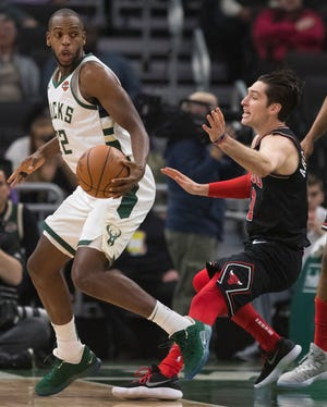 Bucks forward Khris Middleton works against Bulls guard Ryan Arcidiacono during the first half Wednesday night.