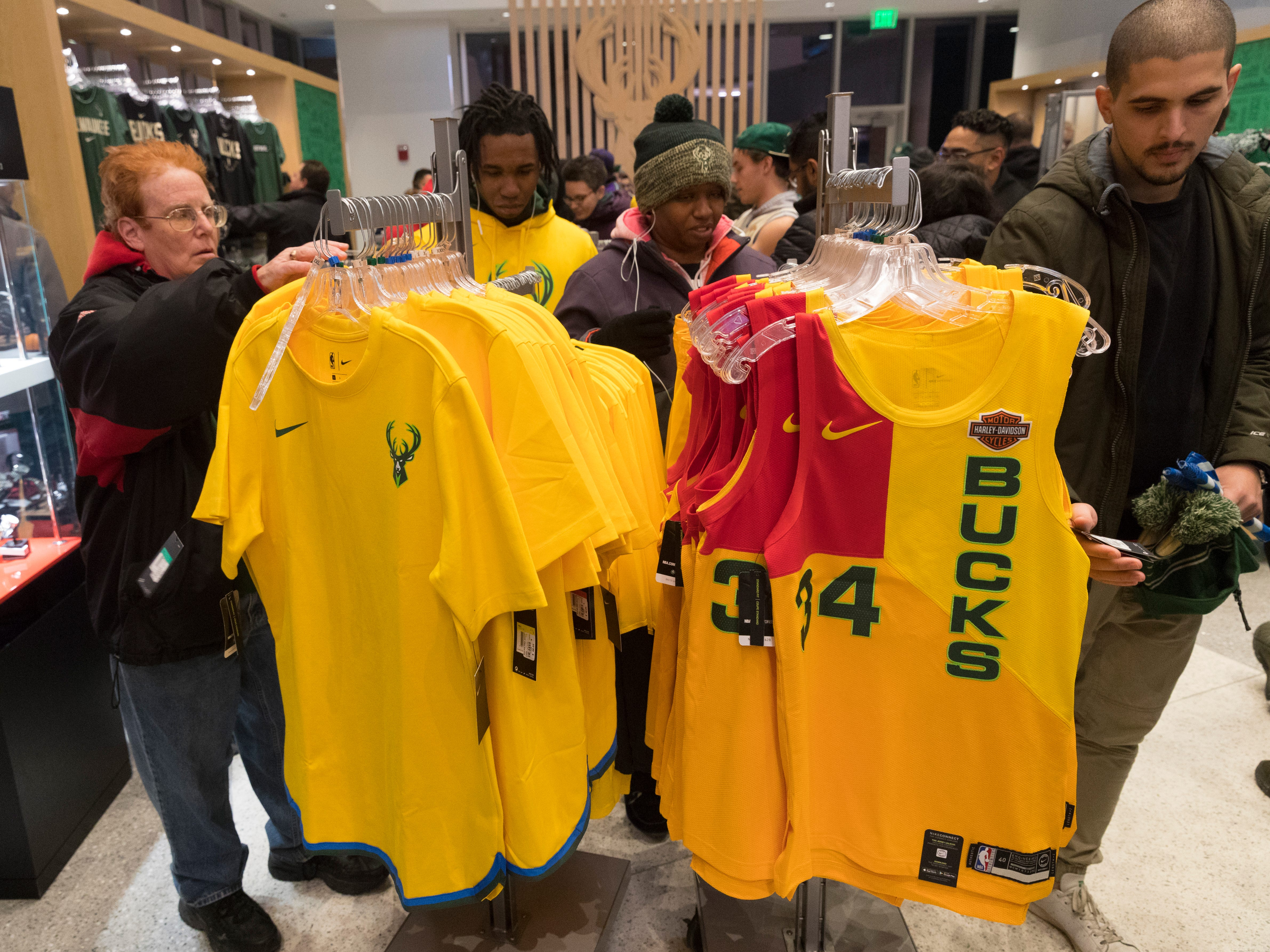 Fans shop for souvenirs in the Milwaukee Bucks Pro Shop before the  game against the Portland Trail Blazers. New ownership noticed the lack of Bucks gear on fans around town and revamped their pro shop strategy.
