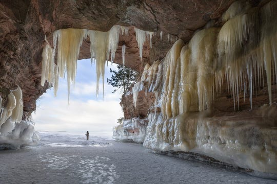 The opening of the Apostles Islands ice caves is about 60 feet wide and dead ends about 200 feet into the bluff.