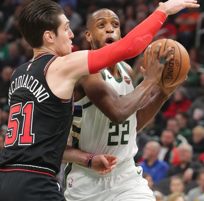 Bucks forward Krish Middleton is fouled by the Bulls' Ryan Arcidiacono on a drive to the basket during the second half on Wednesday night.