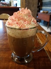 The Coffee Talk Bakery's peppermint mocha has a double shot of espresso, peppermint syrup, chocolate sauce, milk, whipped cream, peppermint candy sprinkles and a candy cane. It costs $4.75.