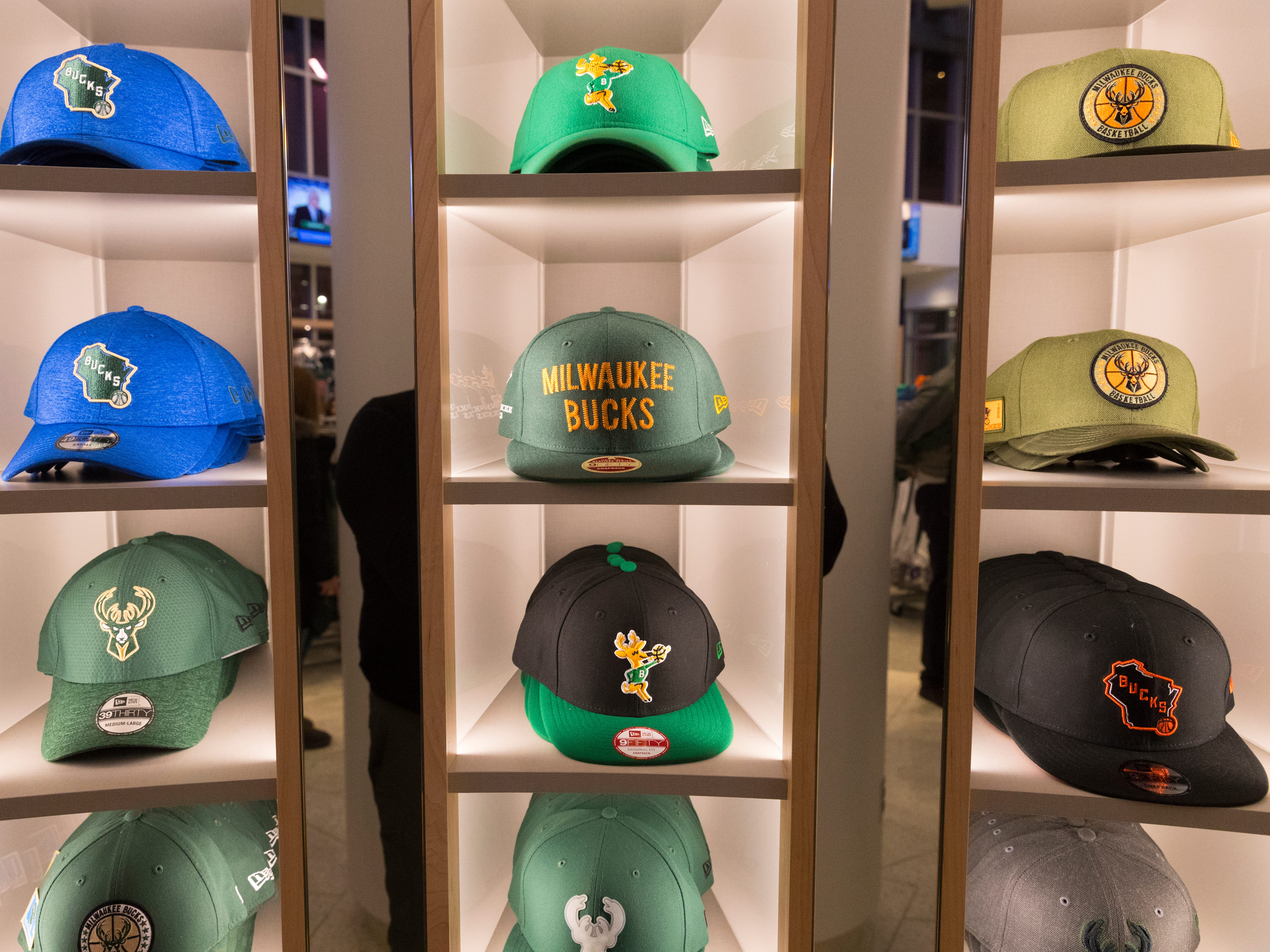 Hats for sale are shown in the Milwaukee Bucks Pro Shop.