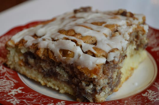 Cinnamon roll cake is a dense cake with cinnamon filling swirled into it and icing on top. A 4x4-inch piece is $3.95.