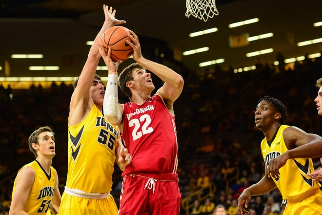 Ethan Happ and the Badgers had a tough time against Luka Garza (55) and the Hawkeyes when they played in January last season.