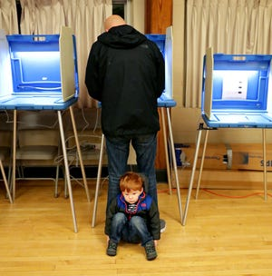 Two-year-old Lennon Buchman waits for his dad, Damian Buchman of Wauwatosa, to vote at the Hart Park Senior Center during the 2018 midterm election.