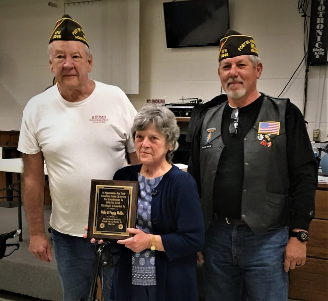 Mike and Peggy Mullinwere honored for over 20 years of leadership to the VFW Post 3246 in Mountain Home. The couple received a plaque in appreciation for their service. Pictured are: (from left) Mike Mullin, Senior Vice Post Commander; Peggy Mullin; and Ronnie Young, Post Commander.