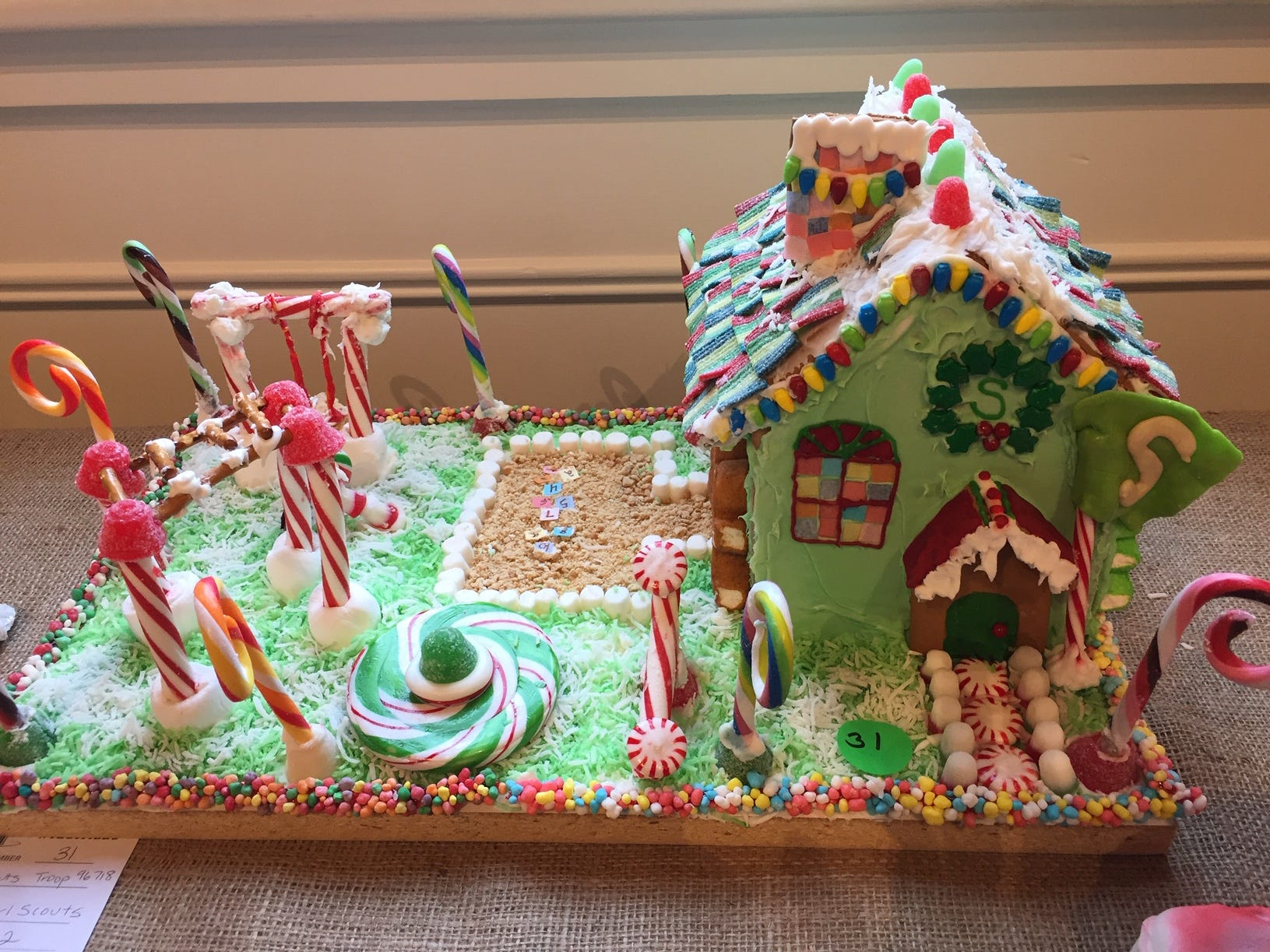 """Shongum School playground"" by Randolph Girl Scout Troop 96718 at the 2018 Gingerbread Wonderland at the Frelinghuysen Arboretum. Scout category."