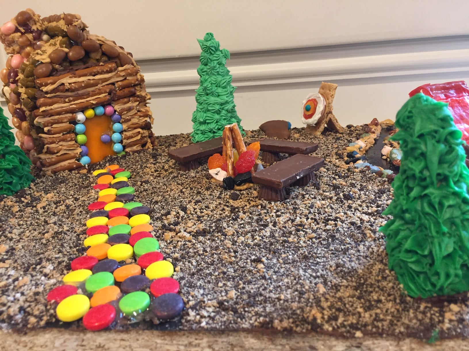 """Girl Scouts go to Camp!"" by Randolph Troop 95703, sixth graders, at the 2018 Gingerbread Wonderland at the Frelinghuysen Arboretum. Scout category."